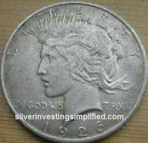 Peace silver dollar prior to cleaning